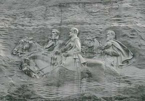 "The massive Confederate Memorial Carving honors Confederate Civil War heroes                                  Jefferson Davis, Robert E. Lee, and ""Stonewall"" Jackson."