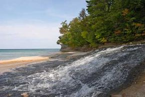 Sandstone cliffs give way to secluded beaches around Pictured Rocks.