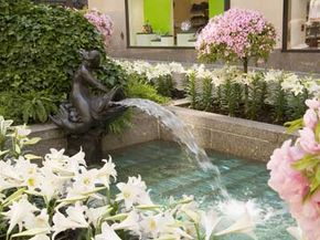 Fountains and decorative foliage add a touch of serenity to Rockefeller Center.