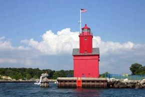 The Holland Harbor Lighthouse (Big Red) can be seen from across the Holland                                  channel at Holland State Park.