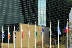 Flags of member nations displayed outside the United Nations complex.
