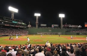 A warm summer night draws crowds of fans to Boston's Fenway Park.