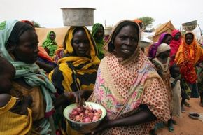 Refugees from the Darfur Region of Sudan flooded the borders of Chad in 2004, leaving the neighboring nation struggling to feed and house their numbers. Here, refugees receive rations of onions, beans, flour and oil.