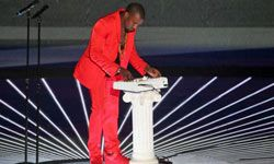 """Kanye's definitely not afraid of bright colors -- this red suit he wore at the 2010 MTV Video Music Awards was so bright it was dubbed """"infrared."""""""