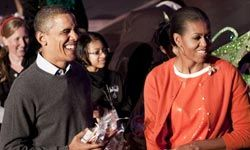 """Stylish First Lady and """"Mom in Chief"""" Michelle Obama loves wearing twin sets, like this one for a White House Halloween celebration."""