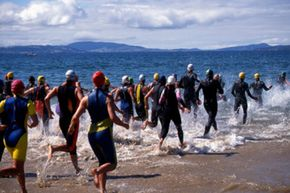 The swimming section of the triathlon is most people's weakest spot -- how can you get a good start and surge ahead of the pack?