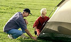 Camping is a great way to teach your son tricks of the outdoor trade.