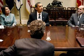 U.S. President Barack Obama (C) holds a meeting with Federal Reserve Chairman Ben Bernanke (R), Federal Deposit Insurance Corporation Chair Sheila Bair (L) in 2009 to talk about efforts to stabilize the economy.