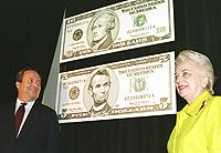 Treasury Secretary Lawrence H. Summers and Treasurer Mary Ellen Withrow unveil the new five and 10 dollar bills in November 1999.
