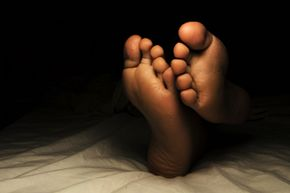 Some cultures believe that spirits might drag you away if you sleep with your feet facing the door.