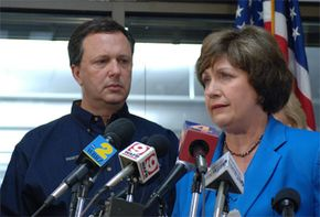 Governor Blanco speaks at a press brefing at the Office of Emergency Management about Hurricane Katrina, while then-FEMA Director Michael Brown looks on.