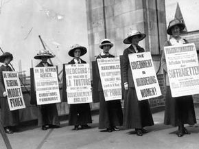 Suffragists marching for the women's vote.