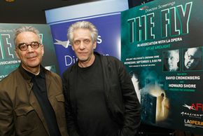 """Film composers provide a movie's musical accompaniment. Composer Howard Shore, left, celebrates with director David Cronenberg, right, at the director's screening of """"The Fly."""""""
