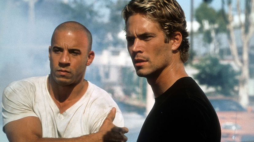 """Vin Diesel (left) and the late Paul Walker in a scene from the 2001 film 'The Fast And The Furious.' This was one flick that critics didn't like but moviegoers did. The eighth sequel, """"F9,"""" should be out the summer of 2021. Universal/Getty Images"""