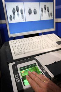 A background and identity check fingerprint capture machine is displayed in London. Modern technologies have made fingerprinting a much more effective means of identification.