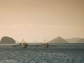Two fishing boats in the Philippines.