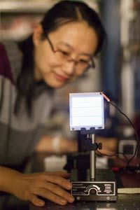 Wake Forest University post-doctoral researcher Wanyi Nie with the FIPEL technology.