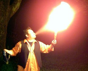 Mike Garner breaths fire. See more bodily feats pictures.