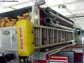 The large black pipes on the side of the engine are the hard suction lines. The walls of these pipes are rigid so that the suction of the pump does not collapse them.