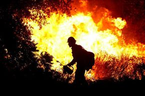 A U.S. Forest Service firefighter… sets a fire? What's all this about? See more pictures of natural disasters.