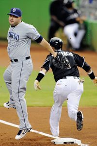 As he ran to first base on July 27, 2012, Miami Marlins player Emilio Bonifacio had to stay within the running lane, or risk being called out for interfering with Yonder Alonso of the San Diego Padres. See more sports pictures.
