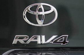 The Toyota RAV4 logo is displayed on the back of a brand new RAV4 at a Toyota dealership in Oakland, Calif.