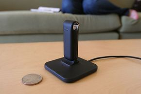The base station charges your FitBit's battery, and every time you pass within about 15 feet of it, the FitBit transfers more of your activity data.