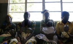 Rwandan women wait for medical treatment at a clinic in Kibuye in 2005. During the Rwandan genocide in the early 1990s, an estimated 25,000 women were tortured through rape.
