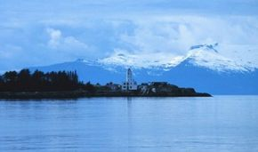 Alaska's Five Finger lighthouse is not as remote as one might think. Each summer, hundreds of boats ply the nearby waters, and visitors on the Inland Ferry and on cruise ships sail by at regular intervals. See more lighthouse pictures.