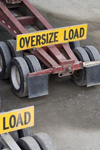 Flatbed trailers can easily tow extremely large and heavy items over long distances.