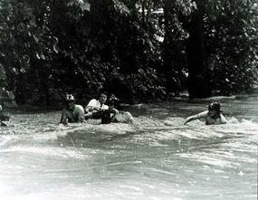 Rescue workers fight upstream against rushing waters in a 1975 flash flood that hit Rockville, Maryland.