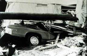 A trailer, car and telephone pole piled up by a 1977 flood in Georgia