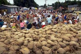 During the flooding of 1993, volunteers in St. Genevieve, Missouri, filled sand bags to build makeshift flood levees.
