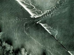 A breeched levee along the Mississippi River, during the great flood of 1927