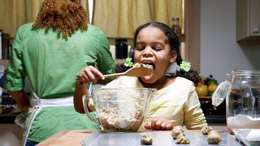 girl eating raw cookie dough