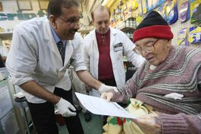 Chief pharmacist Ali A. Yasin (left) gives flu information to Juan Castro (right) after giving him the flu vaccine in New York. The elderly are more vulnerable than the young to the flu's ravages, but only 33 percent of seniors polled knew that.