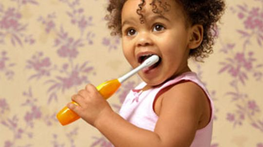 When can you use fluoride toothpaste on toddlers?