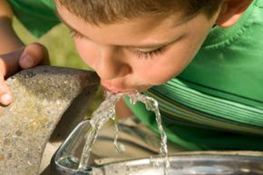 The fluoride in water strengthens teeth enamel, which prevents cavities.