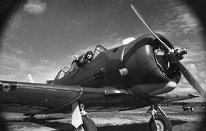 A 1945 photo of an AT-6 two-passenger fighter plane, the first to be flown into a hurricane. See more flight pictures.