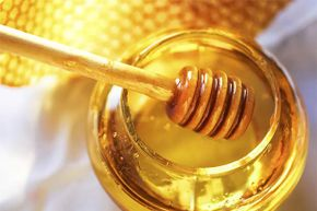 Honey is a natural antibiotic -- yet bees are often injecteted with antibiotics in commercial hives. See our pictures of healthiest foods.
