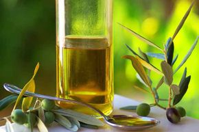 Just like other oils, olive oil is 100 percent fat -- so a little goes a long way.