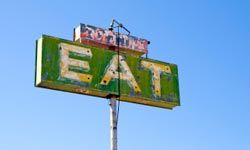 The sign says it all: Food and traveling were meant to be.