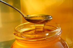 Sticky lids on honey jars can be difficult to open, but that's nothing a little non-stick spray can't help.