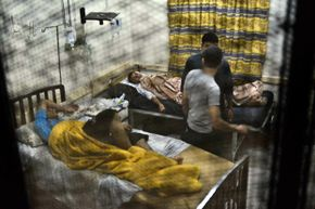 Egyptian students from the al-Azhar University rest in a hospital in Cairo late in 2013, after hundreds suffered food poisoning at a dormitory.