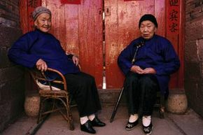 """Two elderly women in Tonghai, China wear tiny """"lotus shoes"""" on their bound feet. Foot binding was a common practice in China for more than 1,000 years before it was outlawed in 1912. See more pictures of China."""