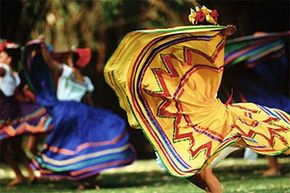 Mexican folk dancers swirl their colorful skirts at a performance in Los Angeles. Folklore is a mix of music, dance, stories, celebration traditions and other rituals.