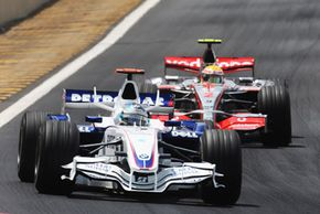 Two cars vie for position in the Brazil Grand Prix on Oct. 21, 2007.