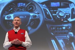 Image Gallery: Car Safety Alan Mulally, CEO of Ford Motor Co., presents the new Ford Sync automotive mobile communications system at the CeBIT technology trade fair on March 1, 2011 in Hanover, Germany. See more car safety pictures.