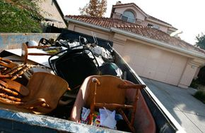 A Dumpster is filled with furniture and personal property in front of a vacant home in October 2007 in Antioch, Calif. California ranks third behind Ohio and Michigan in foreclosures.