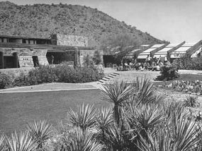 Frank Lloyd Wright surrounded by his students at Taliesin West in 1946.